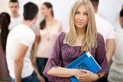 Female student holding notebooks Royalty Free Stock Image