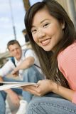 Female Student Holding Papers Royalty Free Stock Image