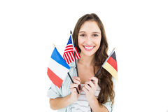 Female student holding several flags Royalty Free Stock Photo