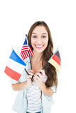 Female student holding several flags Stock Image