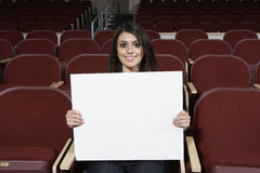 Female Student Holding Sign Board In Classroom Royalty Free Stock Photos