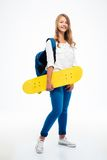 Female student holding skateboard Royalty Free Stock Photo