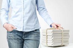 Female Student Holding a Stack of Books Royalty Free Stock Images