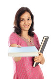 Female student holding text books Stock Photos