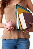 Female Student Holding Textbooks, Files And Piggy Bank Royalty Free Stock Photography