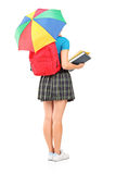 Female student holding an umbrella Royalty Free Stock Image