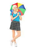 Female student holding an umbrella Royalty Free Stock Photos