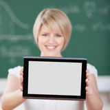 Female student holding up a tablet computer Stock Image