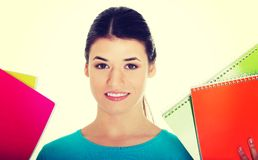 Female student holding workbooks. Stock Photos
