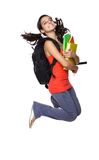 Female student jumping with books in her hand. Teenage girl jumping with books in her hand isolated on white Stock Photography