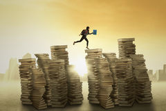 Female student jumps over the books Royalty Free Stock Photography