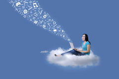 Female student with laptop and flying letters Royalty Free Stock Photos