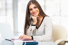 Female student with laptop in a high school library Stock Image