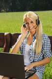 Female student with laptop in lap Stock Photos