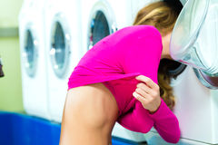 Female student in a laundry Stock Photography
