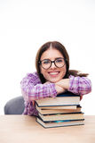Female student leaning on the with books Royalty Free Stock Images