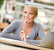 Female student learning at the table Stock Image