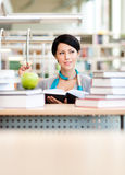 Female student learns at the reading hall Stock Photos