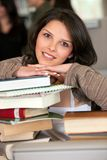 Female student at the library Stock Images