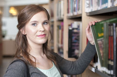 Female student in library Royalty Free Stock Image