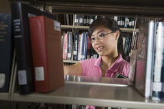 Female Student In Library Stock Photography