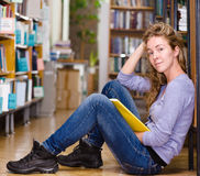 Female student in library. Female cute student in library Stock Images