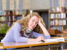 Female student in library. Stock Images