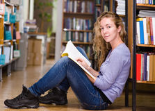 Female student in library Stock Photos