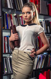 Female student at the library Royalty Free Stock Photos