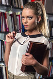 Female student at the library Royalty Free Stock Images