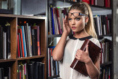 Female student at the library Royalty Free Stock Photography
