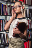 Female student at the library Stock Photos