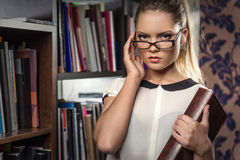 Female student at the library Royalty Free Stock Image