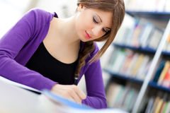 Female student in a library Royalty Free Stock Photography