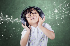 Female Student Listening Music Stock Photo