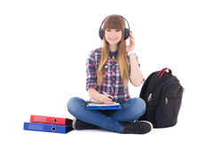 Female student listening music and studying Royalty Free Stock Images