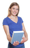 Female student with long blonde hair showing a book Royalty Free Stock Photography