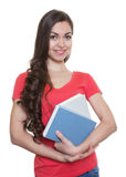 Female student with long dark hair and books Stock Photos