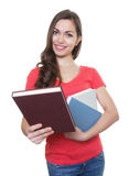 Female student with long dark hair showing a book Royalty Free Stock Photo
