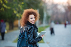 Female student looking back at camera Royalty Free Stock Images