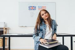 Female student looking at camera. English language school. stock images