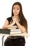 Female student looking at her books hands clasped Stock Photo