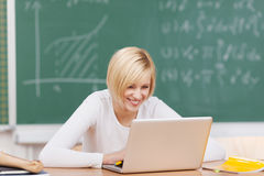 Female Student Looking At Laptop In Classroom Stock Photos