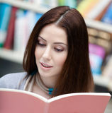 Female student looks through the book Stock Image