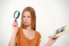 Female student with  loupe Stock Image