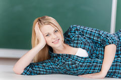 Female Student Lying On Desk In Classroom Stock Photos