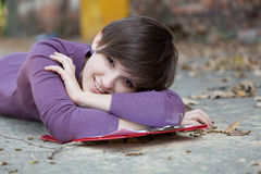 Female student lying near the wall Royalty Free Stock Photo