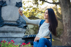 Female student making selfie photo on smartphone Stock Photography