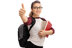 Female student making a thumb up sign Royalty Free Stock Image