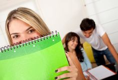 Female student with a notebook Stock Images
